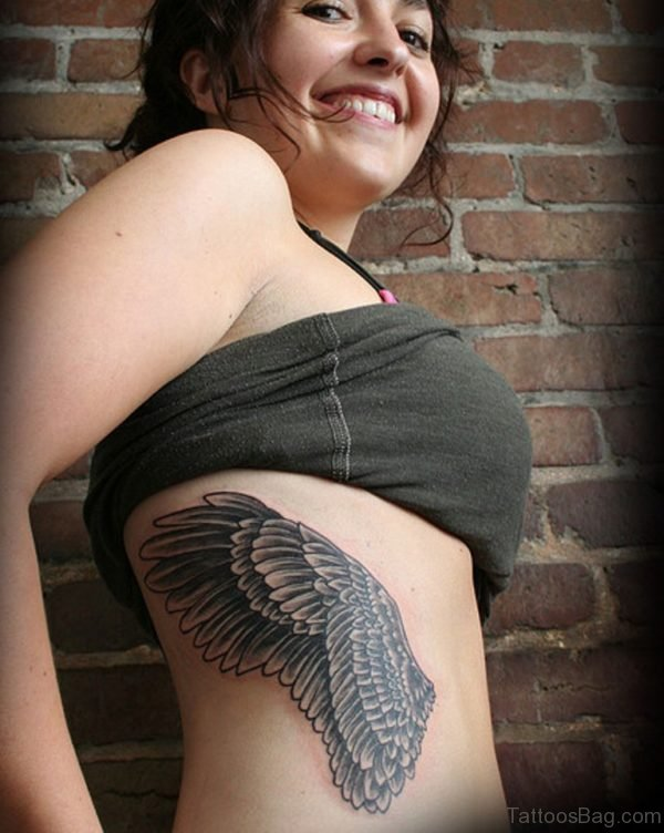 Wing Tattoo On Rib Tattoo