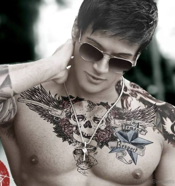 Winged Skull With Guns And Roses Chest Tattoo