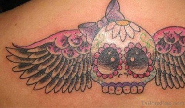Winged Sugar Skull Tattoo On Upperback