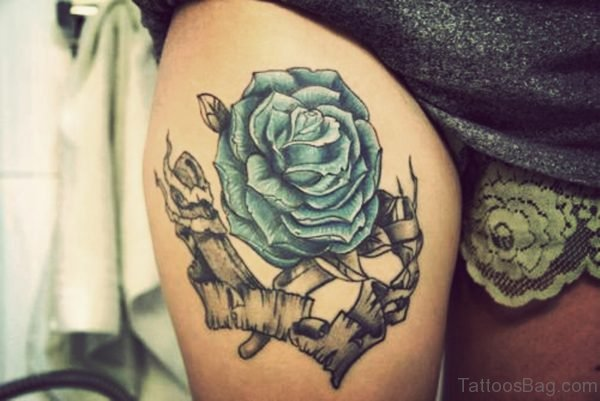 Wonderful Blue Rose Tattoo On Thigh