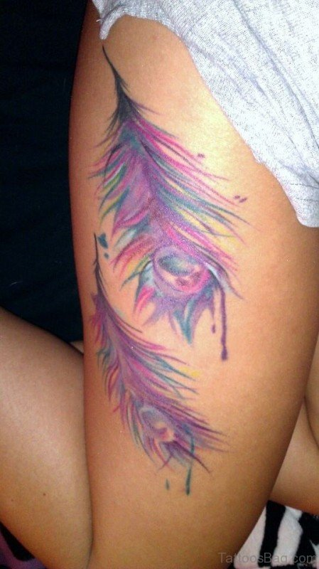 49 superb peacock tattoo on thigh for Feather tattoo on thigh
