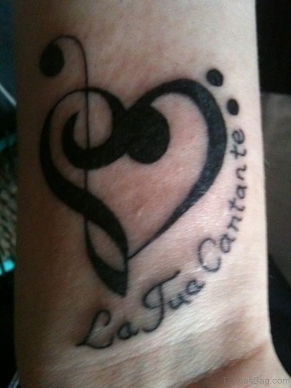 Wording And Music Note Tattoo On Wrist
