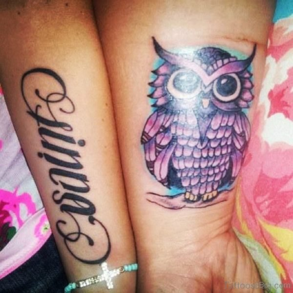 Wording And Owl Tattoo On Wrist