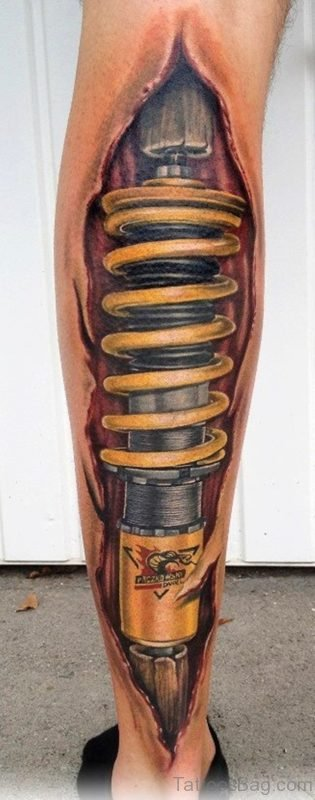 Yellow Bio Mechanical Tattoo On Leg