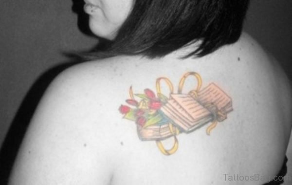 Yellow Book Tattoo On Shoulder