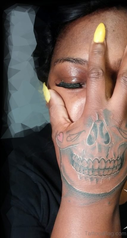 Yellow Nails Skull Tattoo