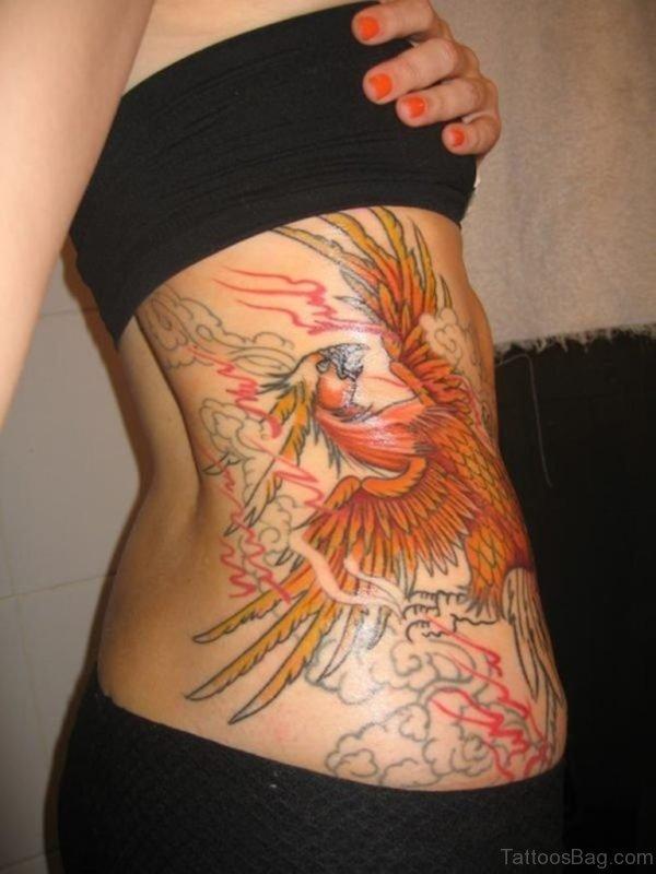Yellow Phoenix Tattoo On Rib