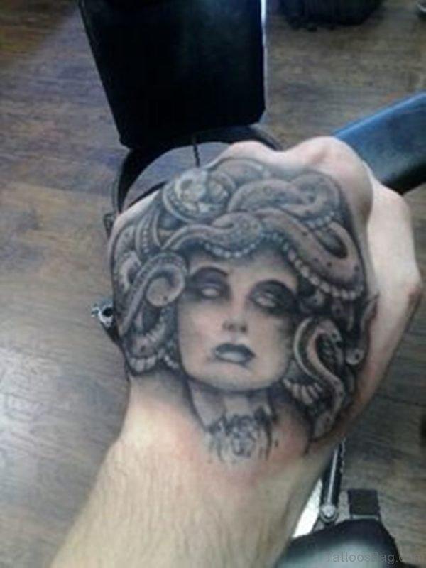 Grey Medusa Tattoo On Hand