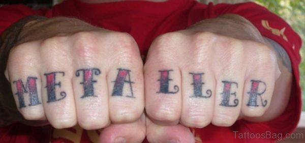 Metaller word Tattoo On knuckle