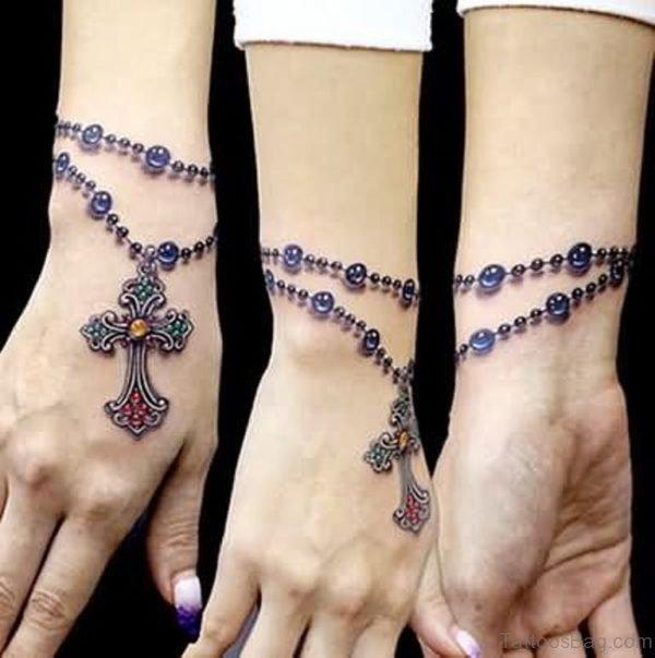 Rosary cross wrist tattoos