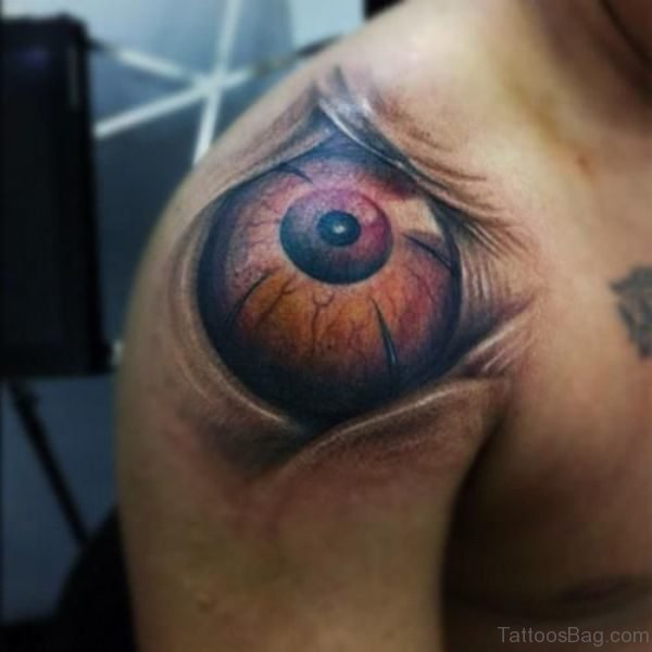 Abstract Brown Eye Tattoo On Shoulder