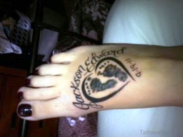 Baby Footprints Tattoo On Heart Outline