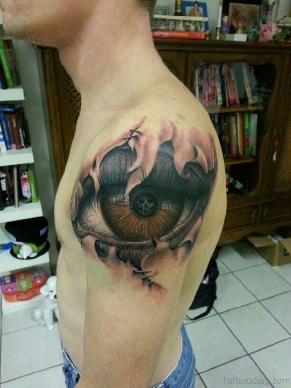 Big Brown Eye Tattoo On Shoulder