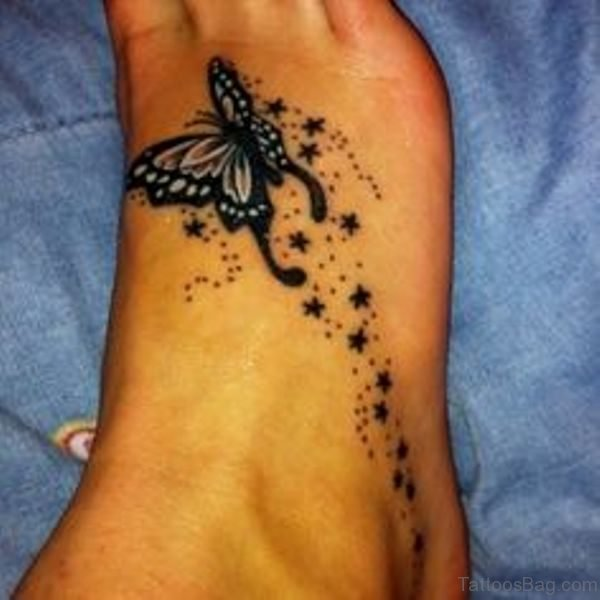 Black Butterfly And Star Tattoo On Feet