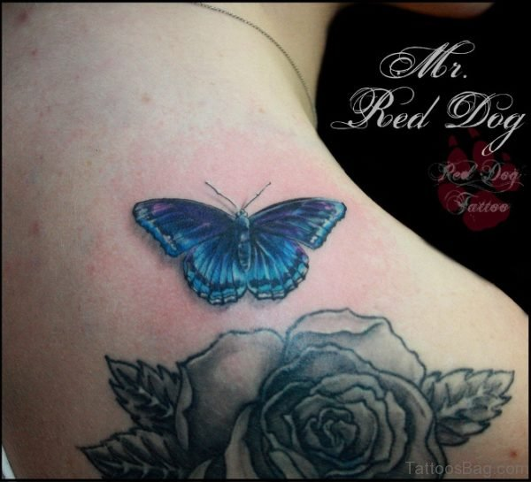 Blue Butterfly And Grey Flower Tattoo