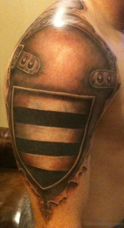 Brown Armour Tattoo On Shoulder
