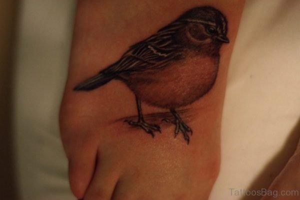 Brown Bird Tattoo On Foot
