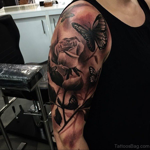Brown Butterfly And Flower Shoulder Tattoo