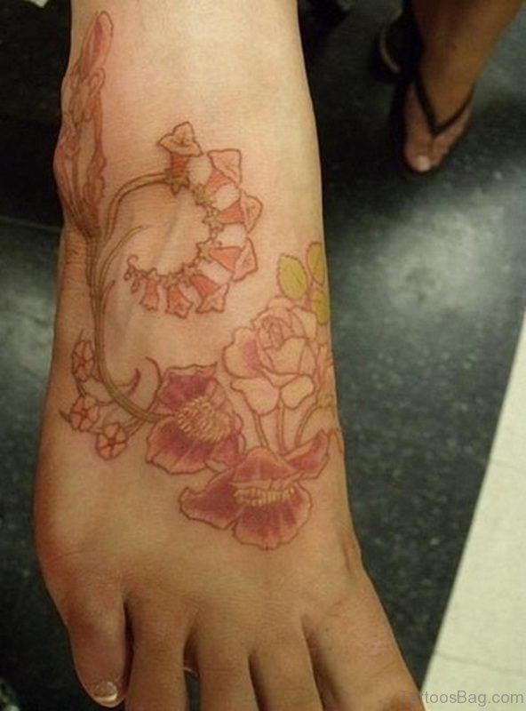 Brown Flower Tattoo On Foot