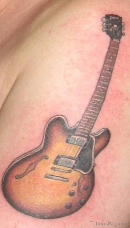 Brown Guitar Tattoo On Shoulder