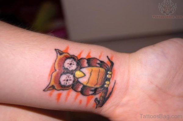 Brown Owl Tattoo On Wrist