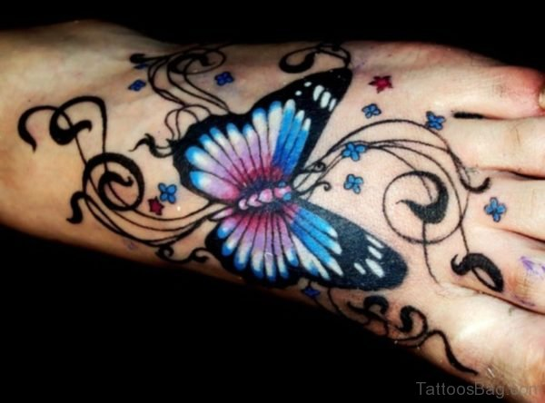 Dark Ink Butterfly And Star Tattoo