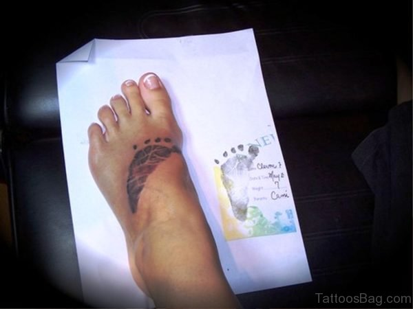 Elegant Baby Footprint Tattoo 1