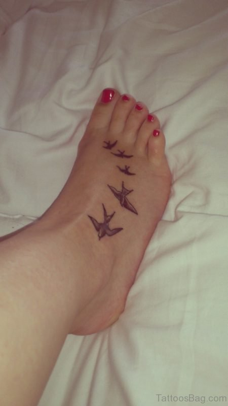 Flying Brown Bird Tattoo On Foot