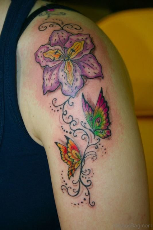 Lovely Butterfly And Star Tattoo On Shoulder