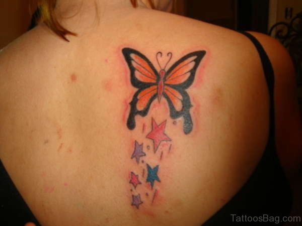 Nice Colored Butterfly And Star Tattoo