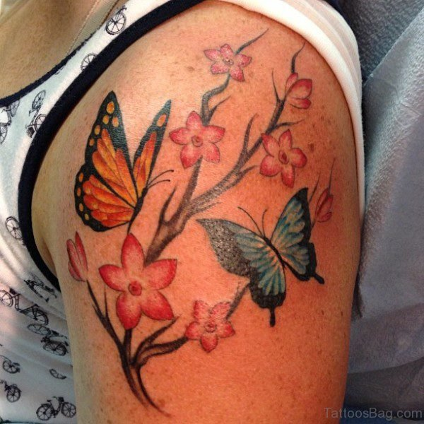 Orange Butterfly And Flower Tattoo On Shoulder