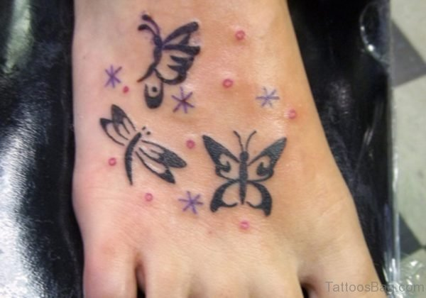 Simple Butterfly And Star Tattoo